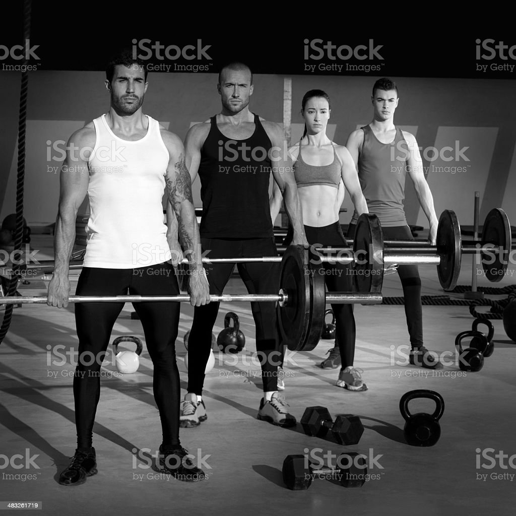 gym group with weight lifting bar gym workout stock photo