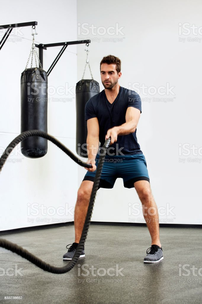 Gym guy with ropes stock photo