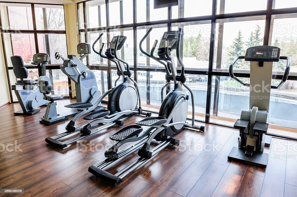 Gym interior with many treadmill machines stock photo