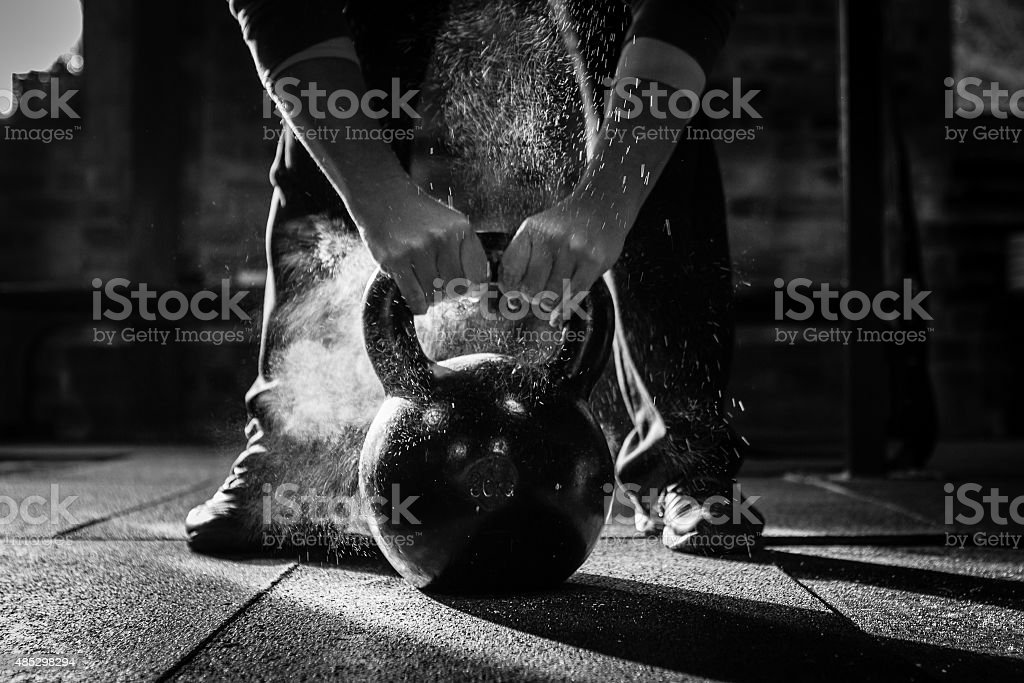 gym Kettle Bell with chalk and hands stock photo