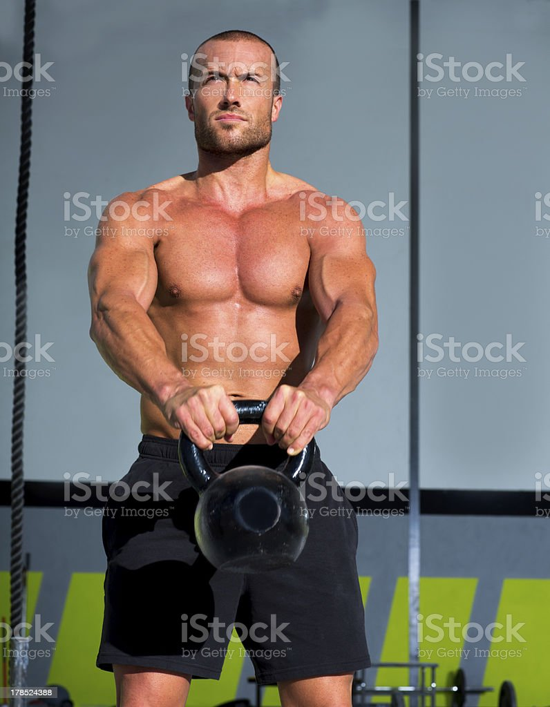gym Kettlebells swing exercise man workout royalty-free stock photo