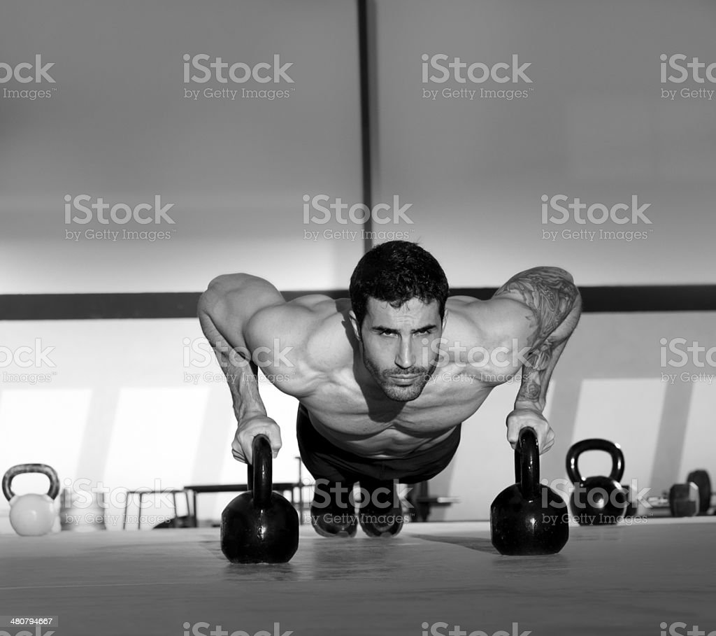 Gym man push-up strength pushup with Kettlebell royalty-free stock photo