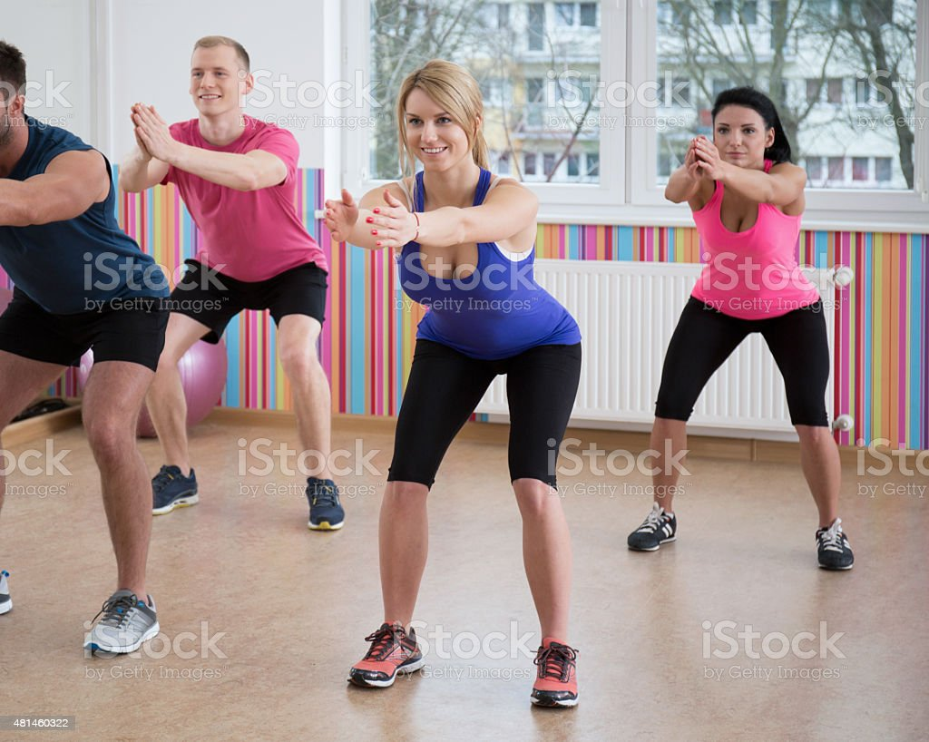 Gym people doing squats stock photo