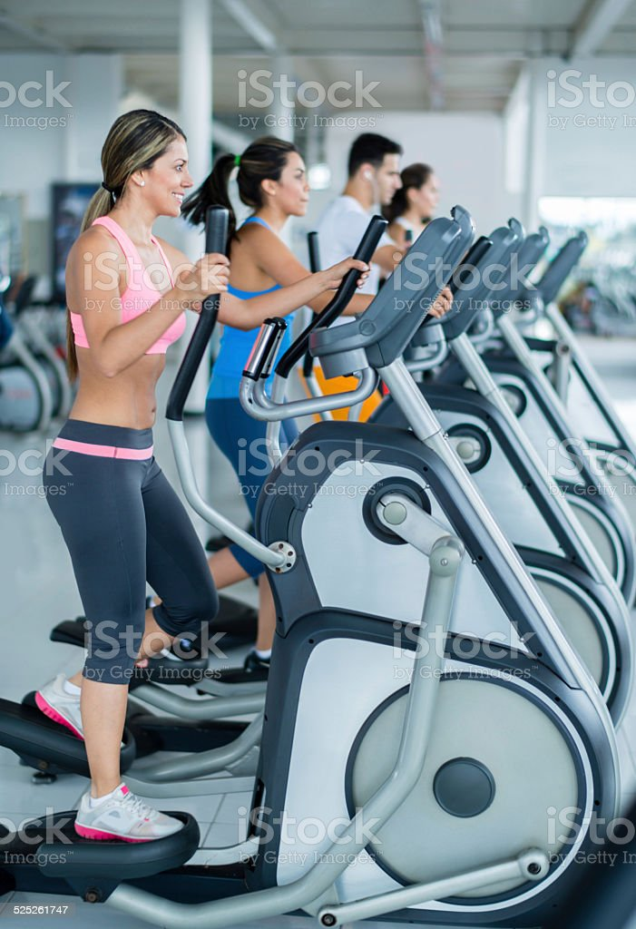Gym people on cross trainers stock photo