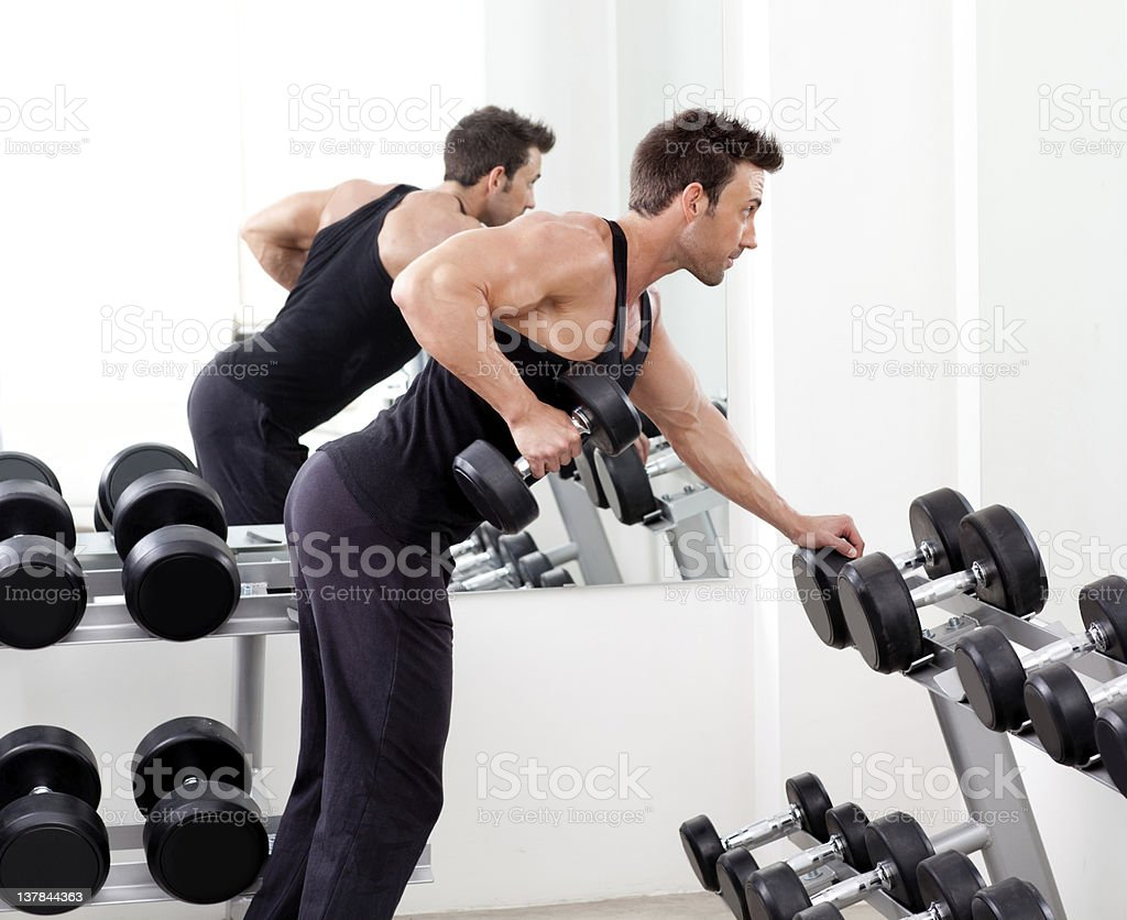 gym personal trainer man with weight training stock photo