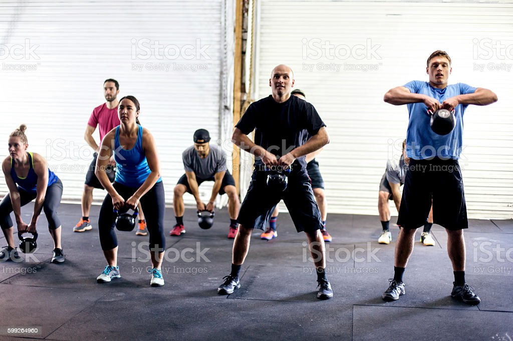 Crossfit team doing exercises