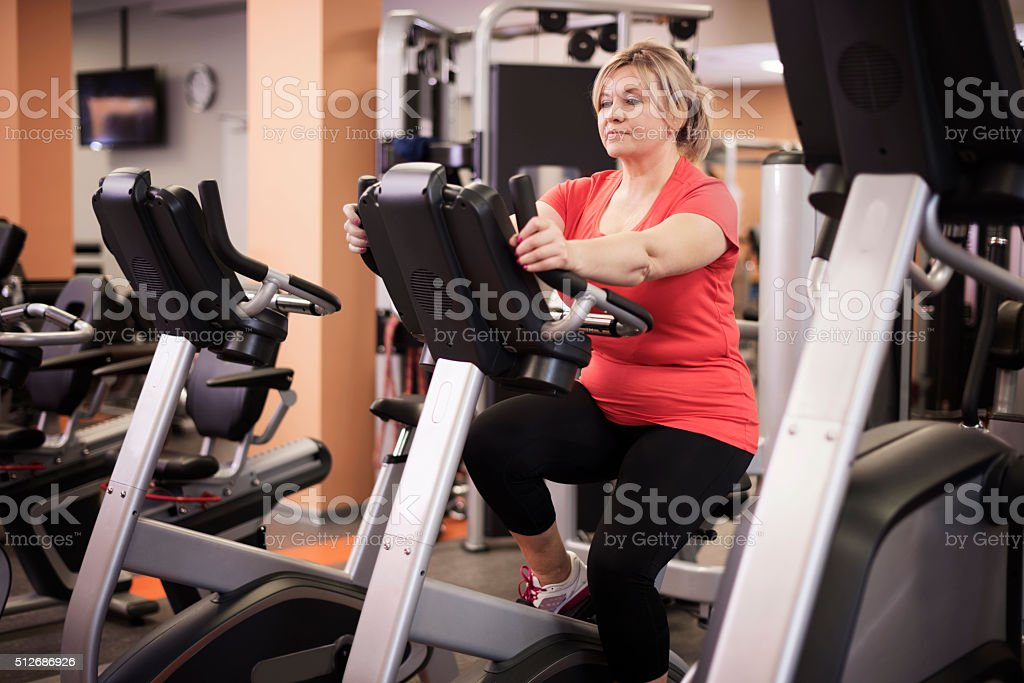 Gym time for mature woman stock photo