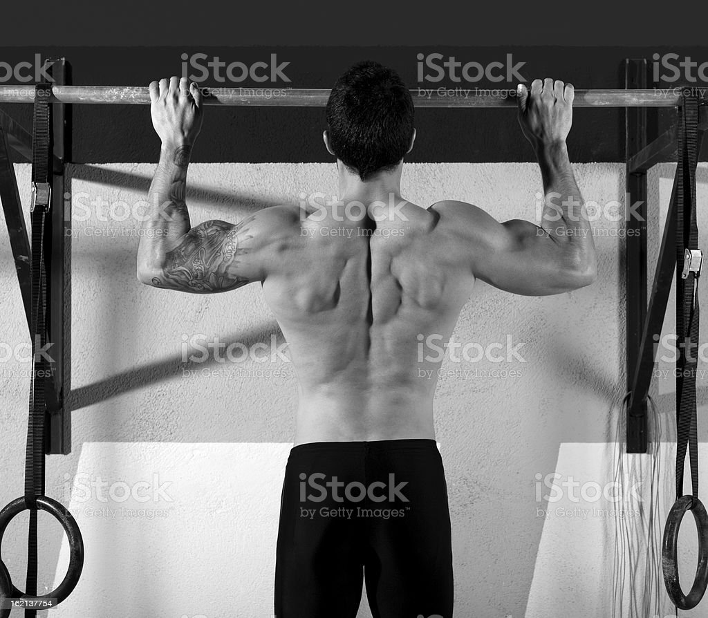 gym toes to bar man pull-ups 2 bars workout royalty-free stock photo