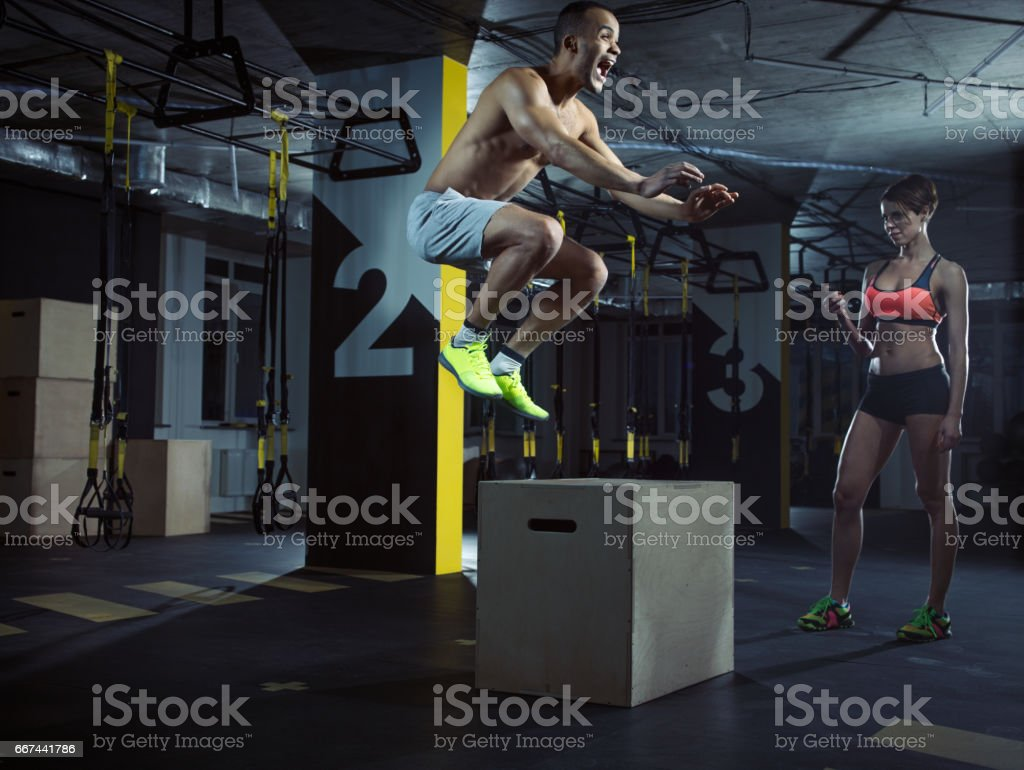 Gym training: Male athlete in action stock photo