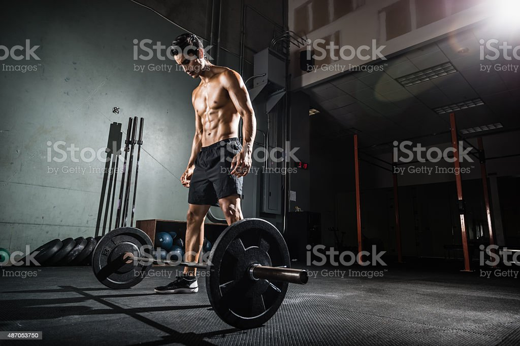 Crossfit Training with a Barbell stock photo