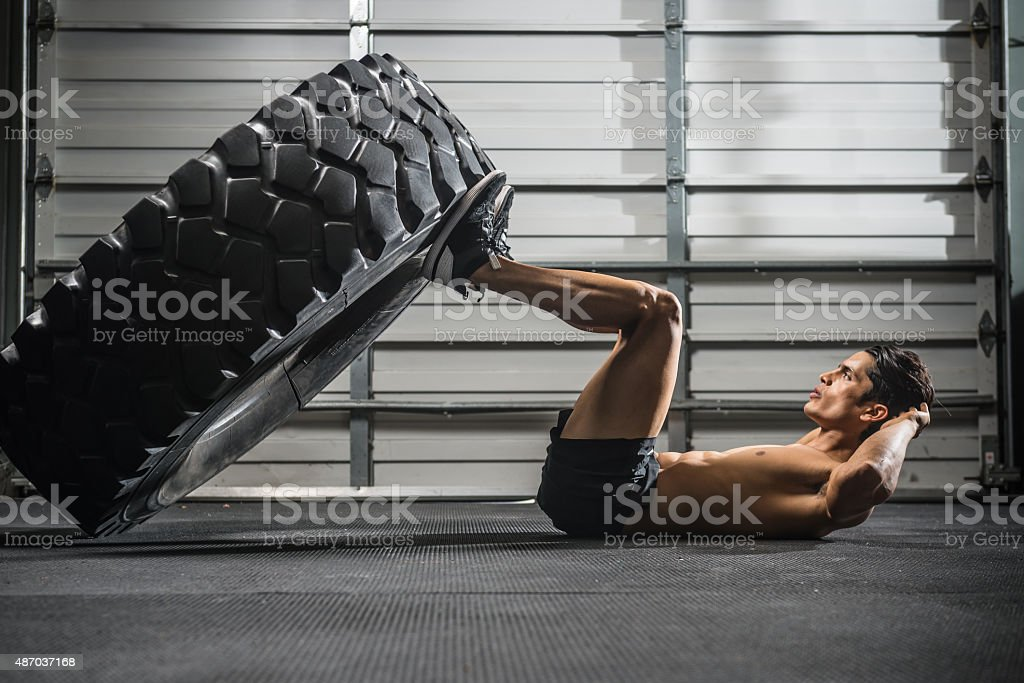 gym Training with a Large Tire stock photo