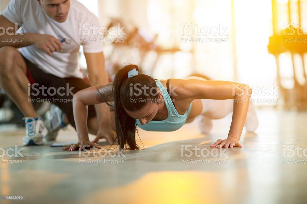 Gym woman doing push ups stock photo