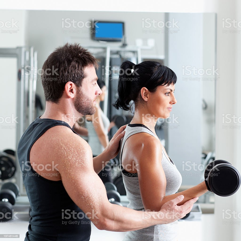 gym woman personal trainer with weight training royalty-free stock photo