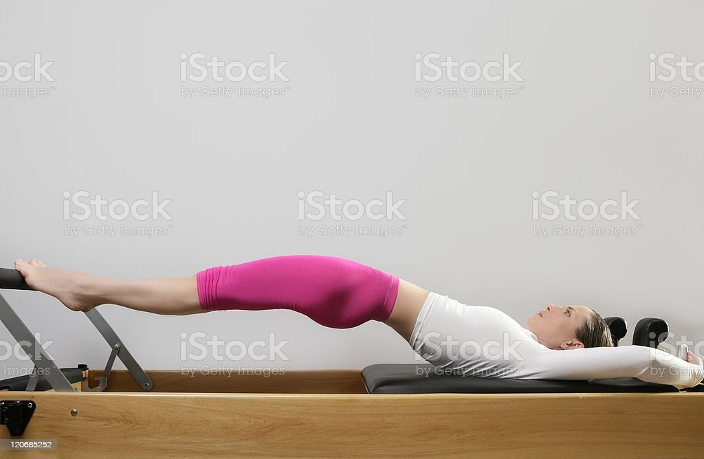 gym woman pilates stretching sport in reformer bed stock photo