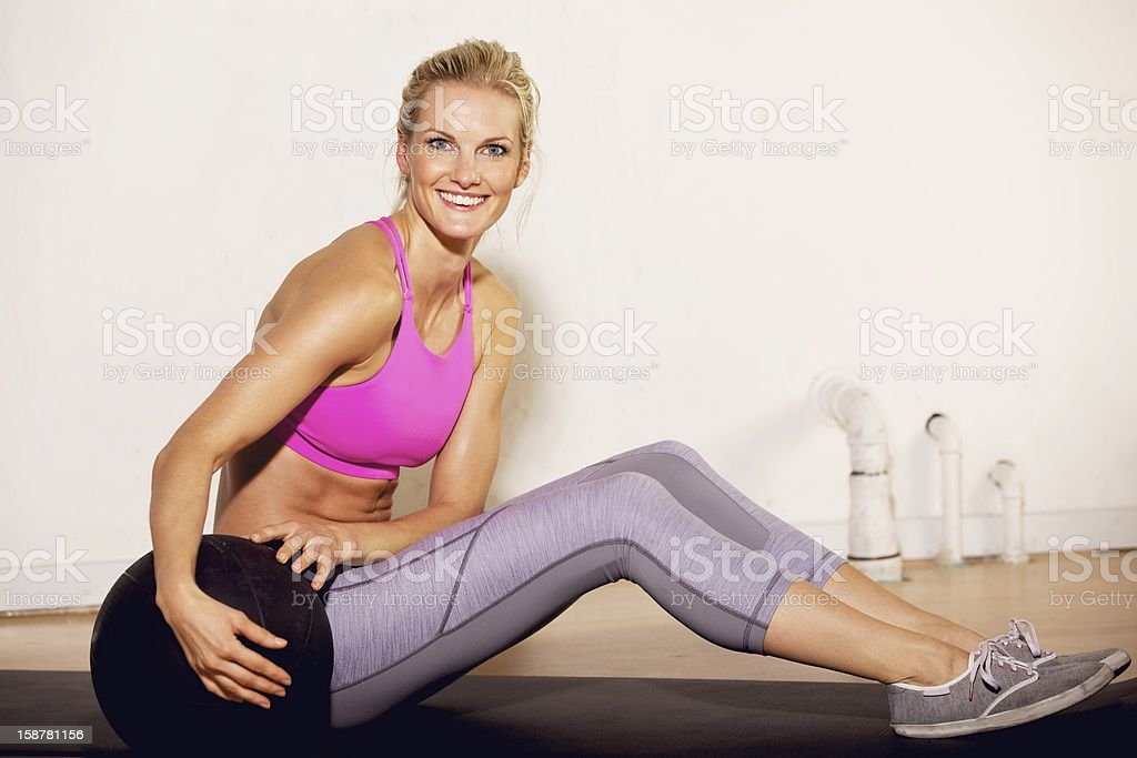 Gym Woman with a Pilates Ball stock photo