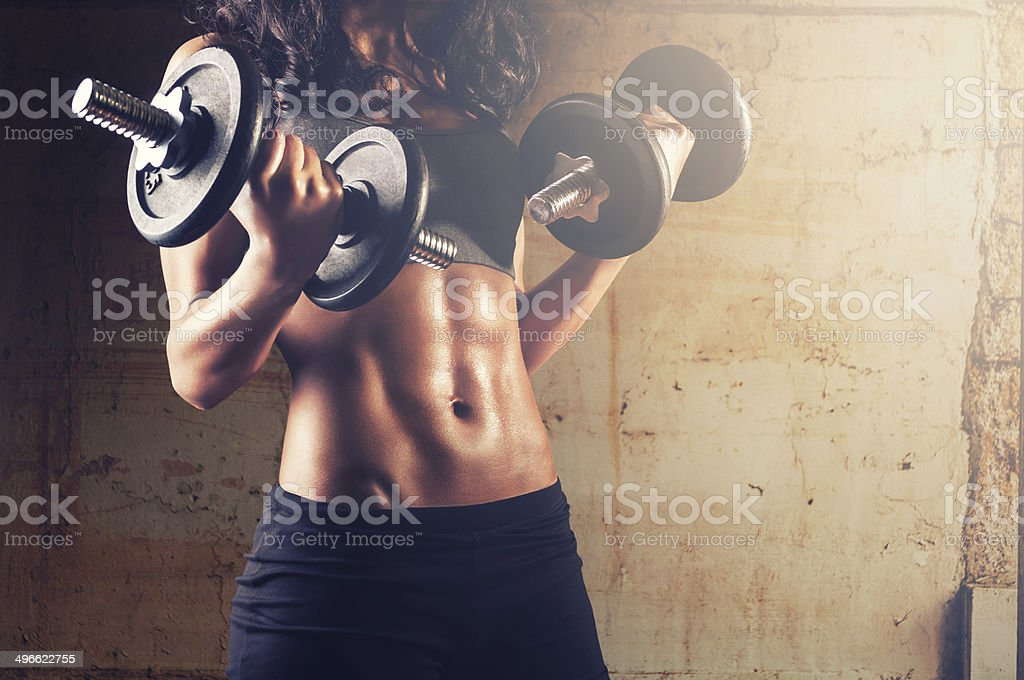 gym woman with dumbbells stock photo