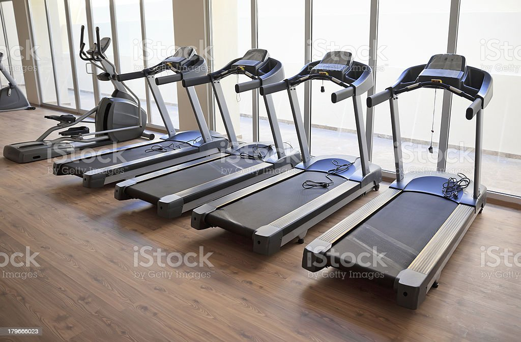 Gymnasium with running machines royalty-free stock photo