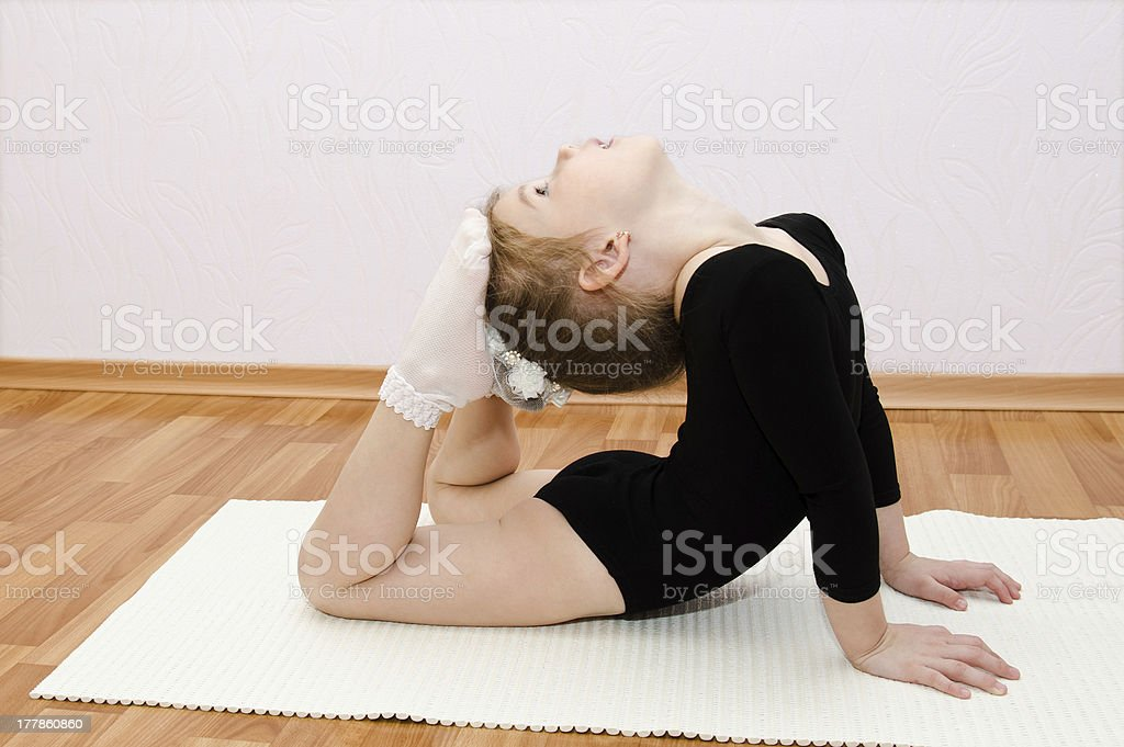 Gymnast cute little girl doing exercises royalty-free stock photo
