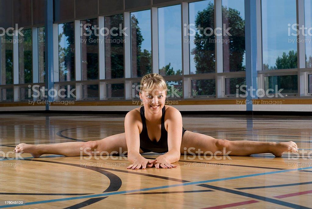 Gymnast doing front splits royalty-free stock photo