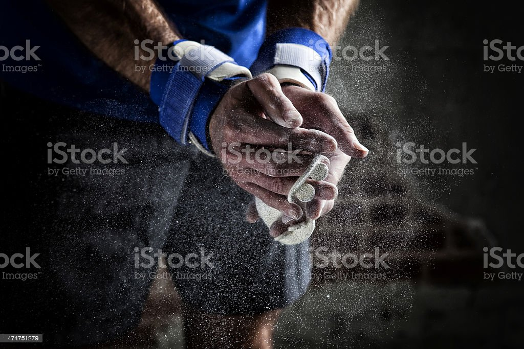 Gymnast Dusting Chalk on His Hands royalty-free stock photo