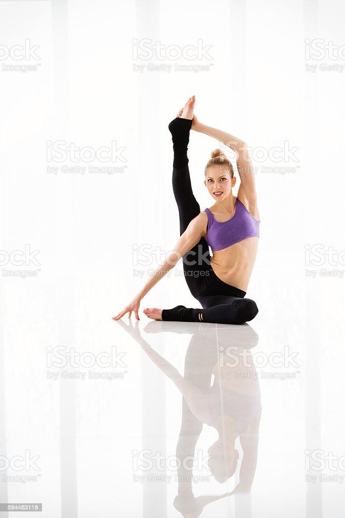 Gymnast girl against white background stock photo