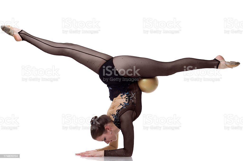 Gymnast girl does a split on white background royalty-free stock photo