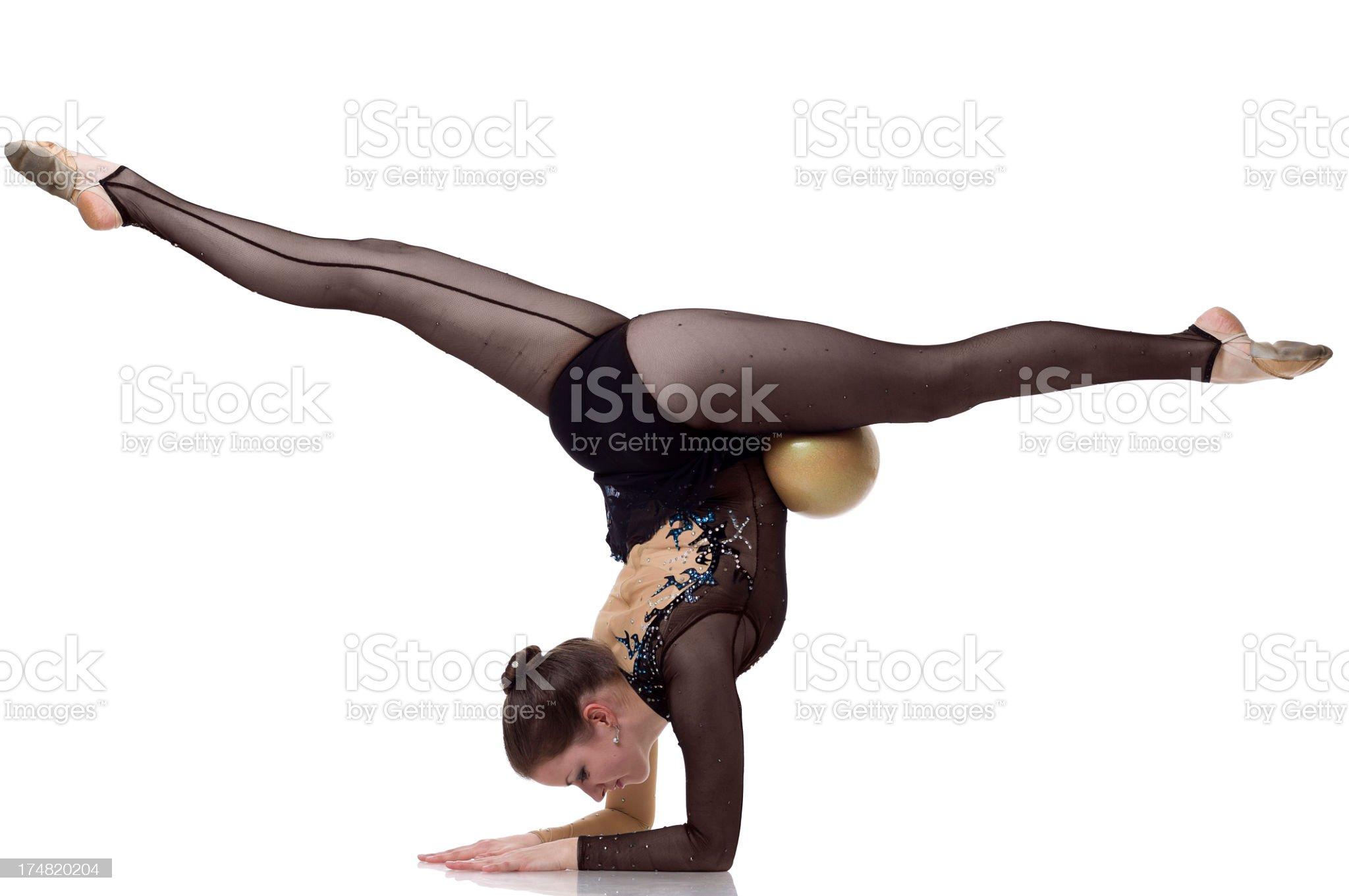 Gymnast girl does a split on white background royalty-free stock photo