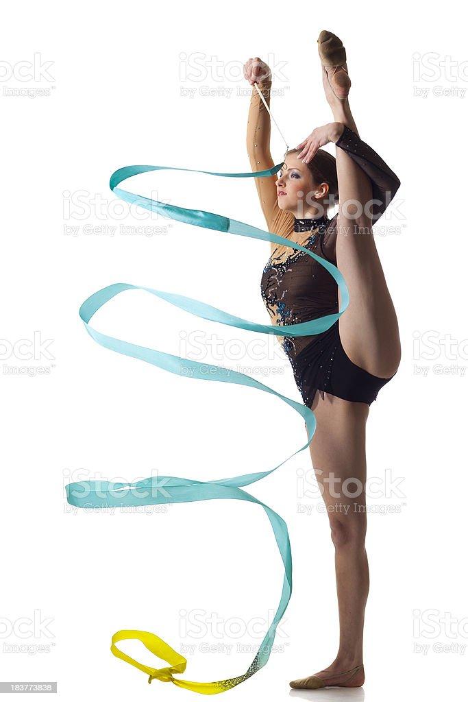 Gymnast girl does a split on white background stock photo