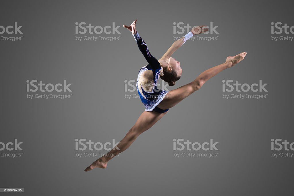 Gymnast girl doing splits in the air stock photo
