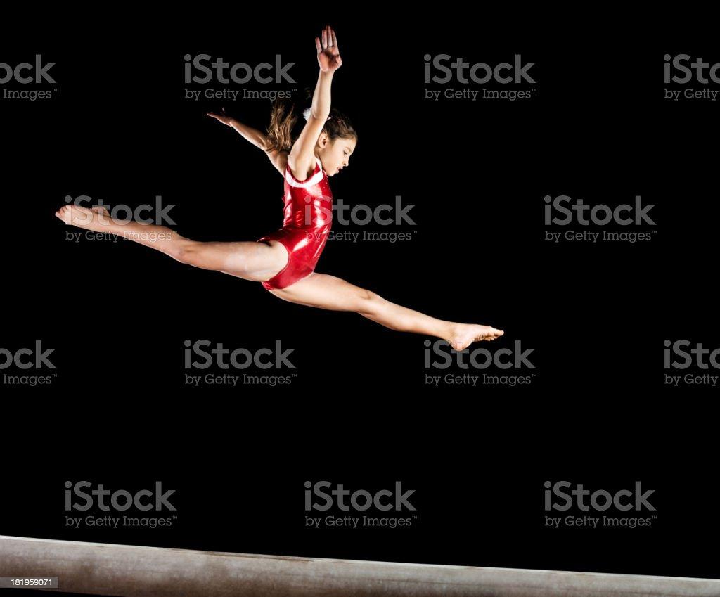 Gymnast girl isolated on black. stock photo