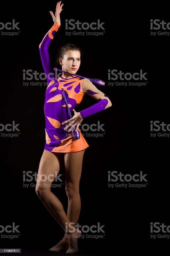 Gymnast girl on black background royalty-free stock photo