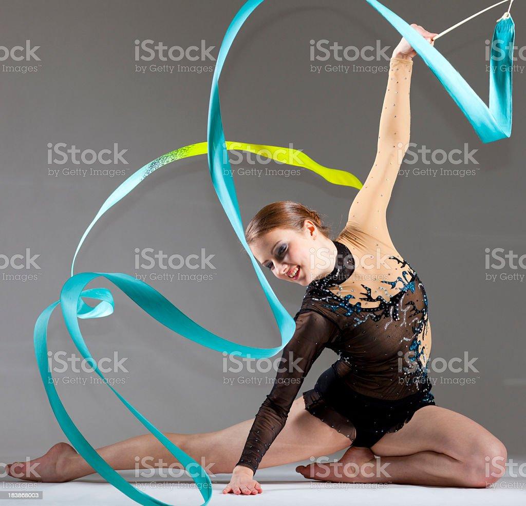 Gymnast girl on grey background stock photo