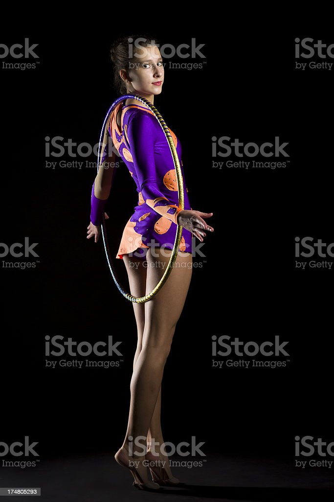 Gymnast girl with hula hoop on black background royalty-free stock photo