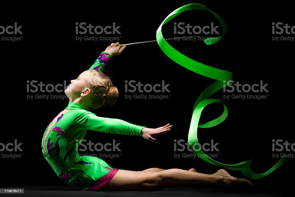 Gymnast girl with Rhythmic Ribbon on black background stock photo