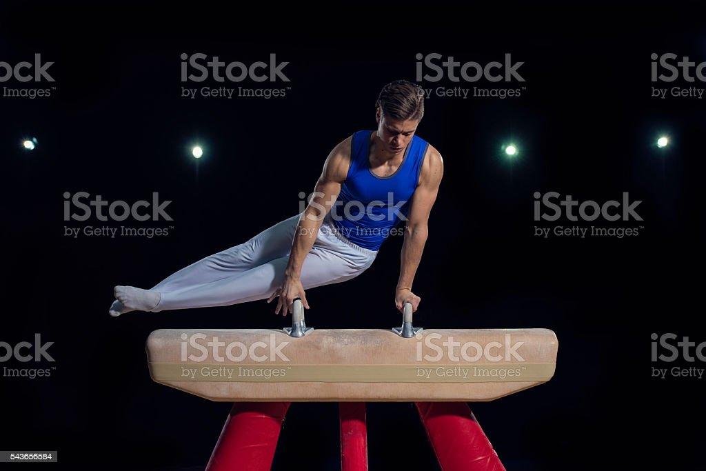 Gymnast on Pommel Horse stock photo