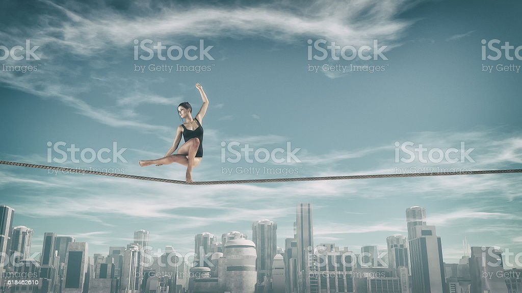 Gymnast tightrope above city stock photo