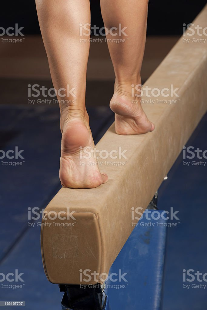 Gymnast walking on tiptoes down balance beam (XXXL) stock photo