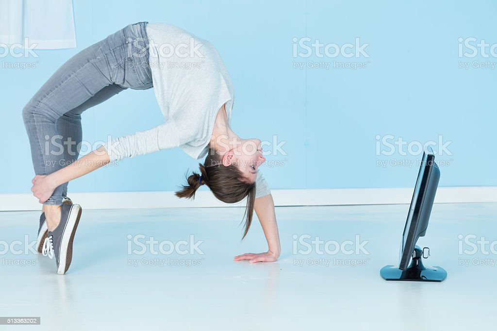 Gymnast Watching Television Whilst Contorting stock photo