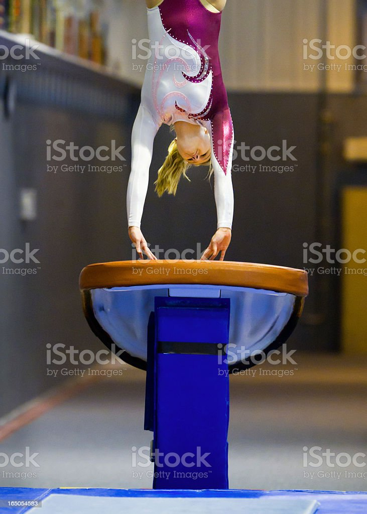 Gymnasts Fingertips on Vault as She Flips Through the Air stock photo