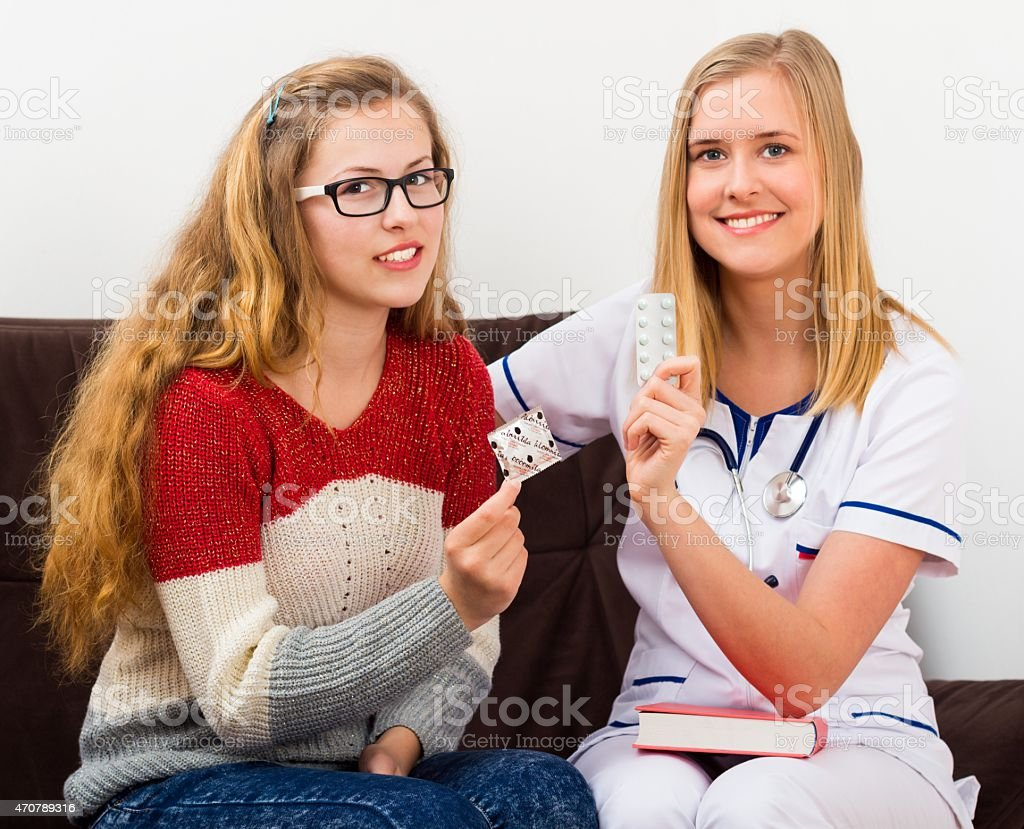Gynecologist Consulting Teenage Girl stock photo