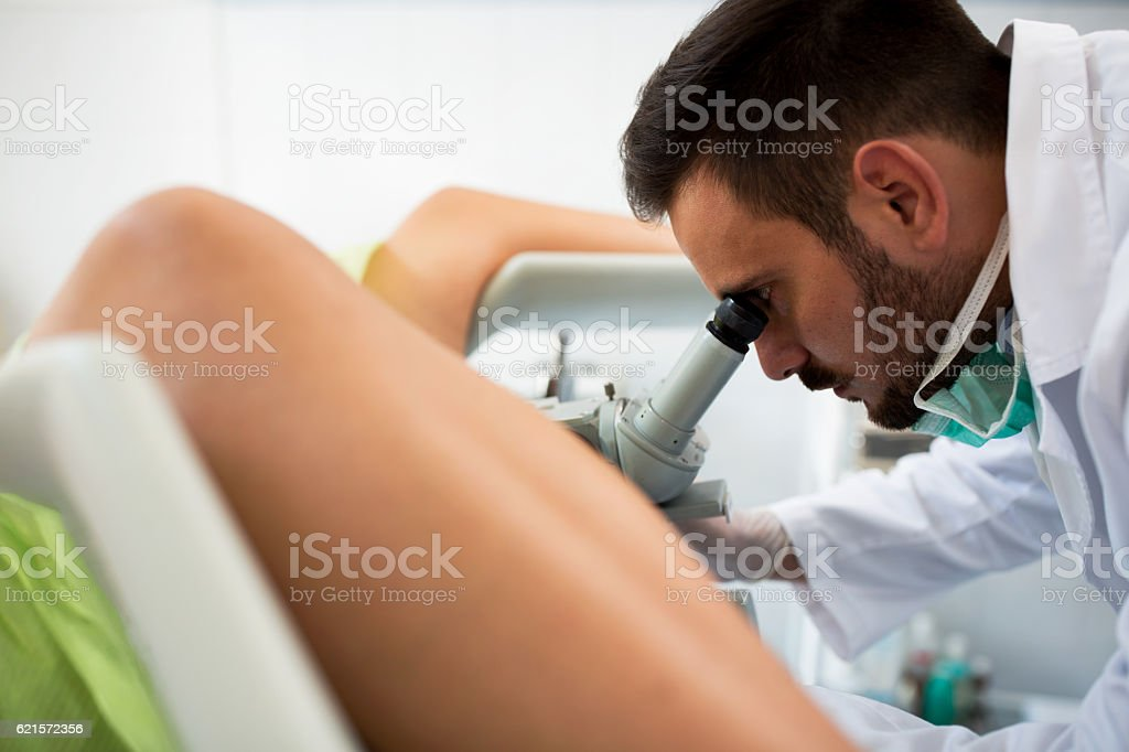 Gynecologist examining a patient with a colposcope stock photo