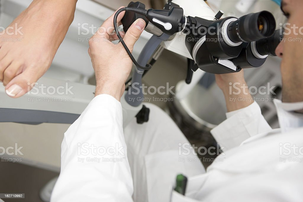 Gynecologist examining patient stock photo
