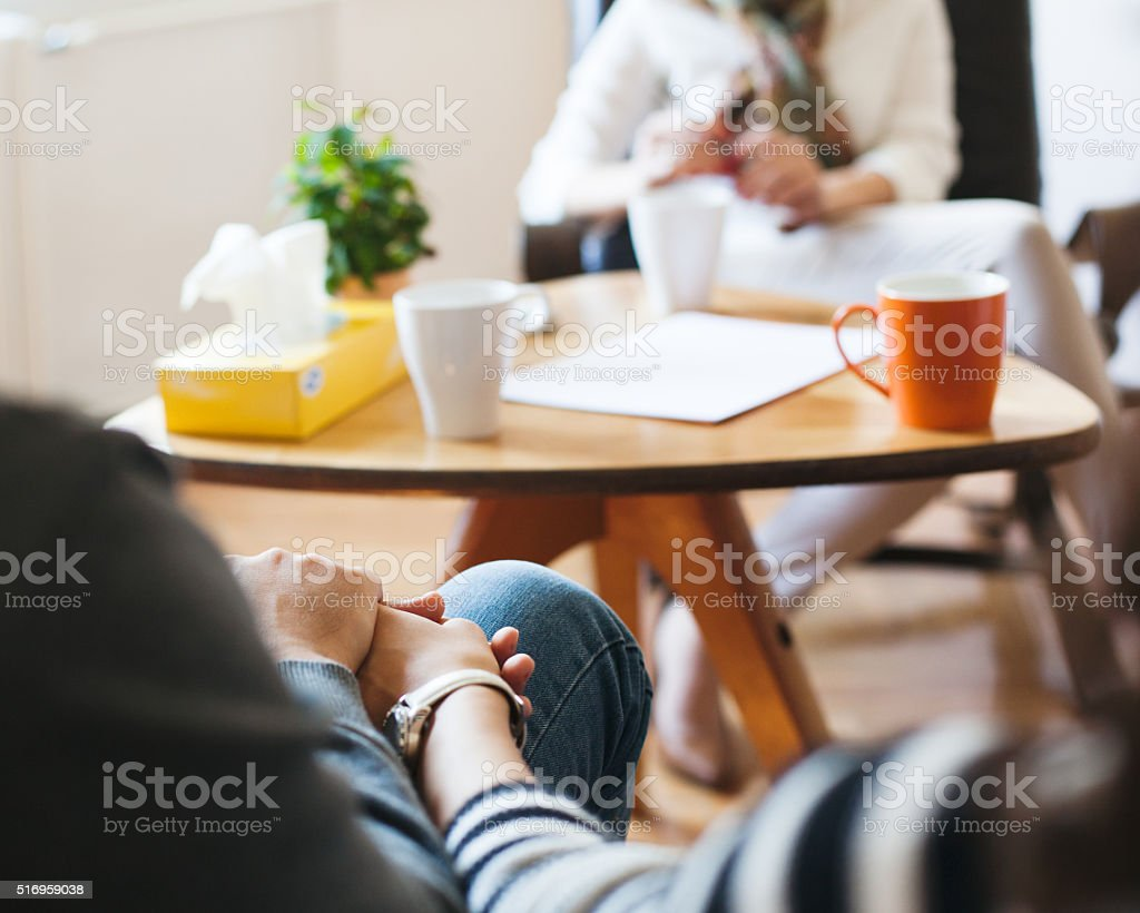 Gynecologist Talking To Pregnant Woman and her husband stock photo