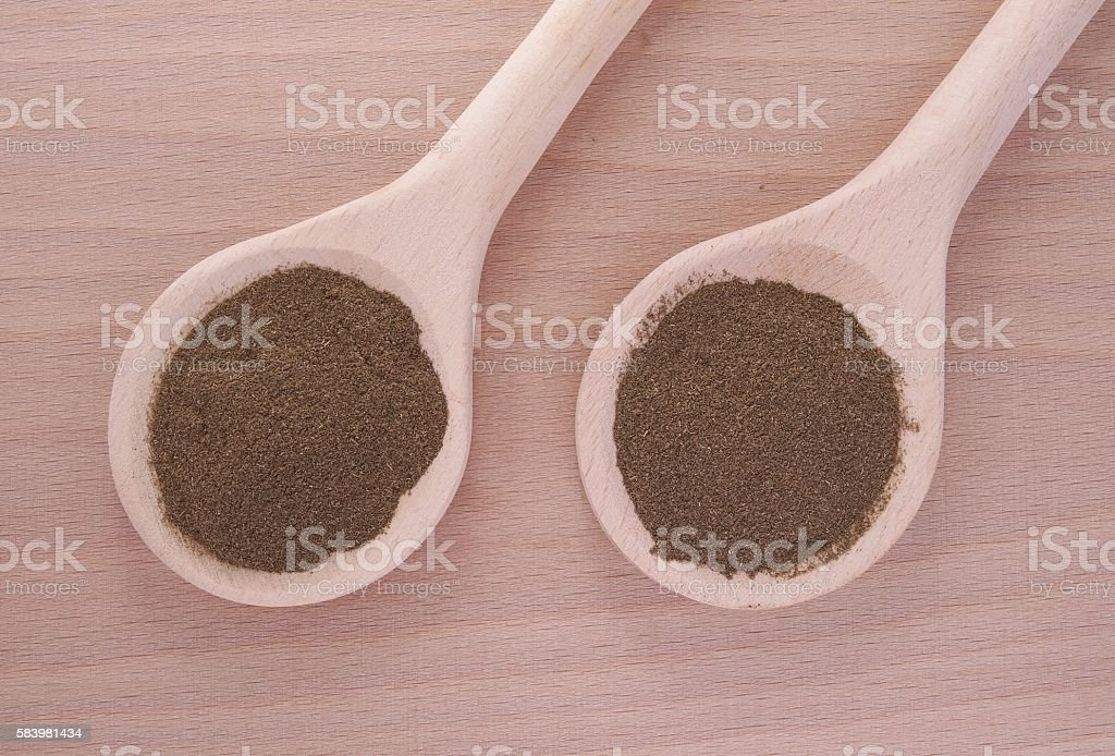 Gynostemma (jiaogulan) powder in wooden spoon stock photo