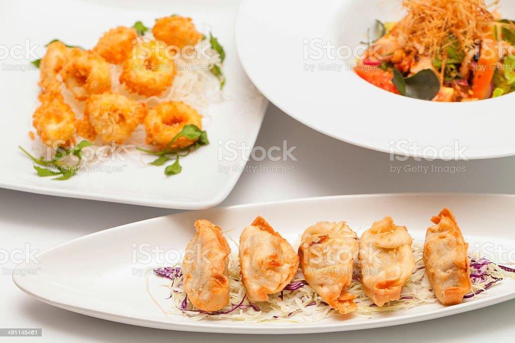 gyoza on a white dish. stock photo