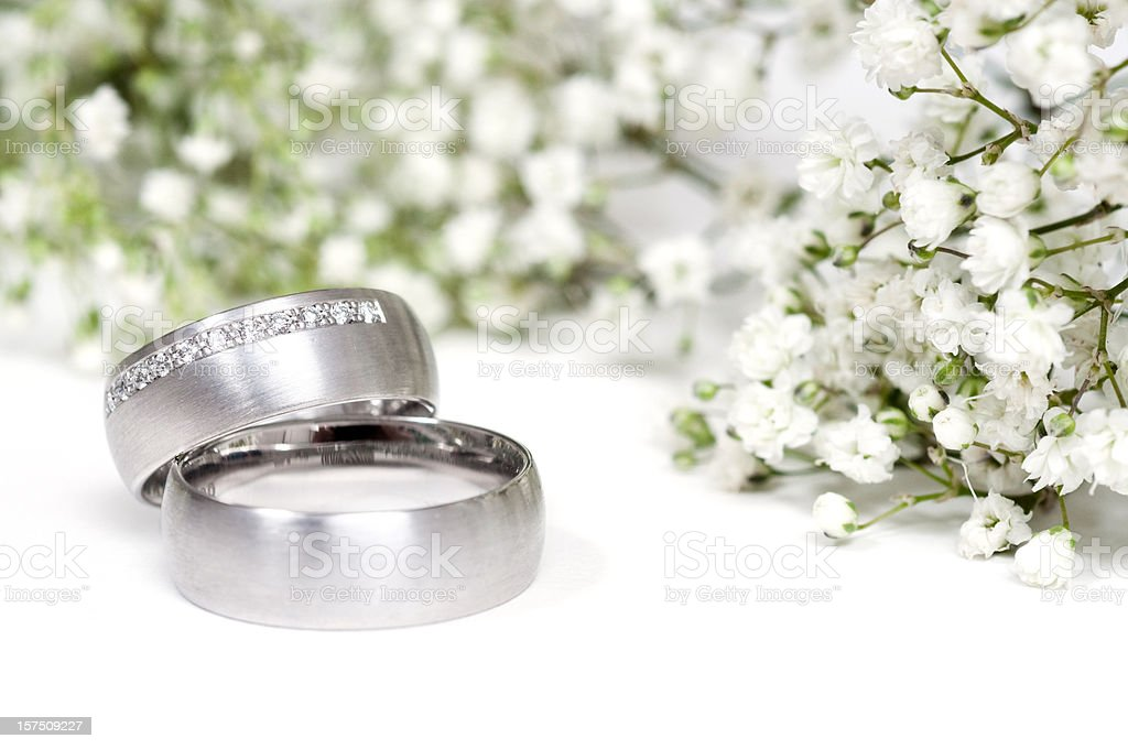 gypsophila and a pair of rings royalty-free stock photo