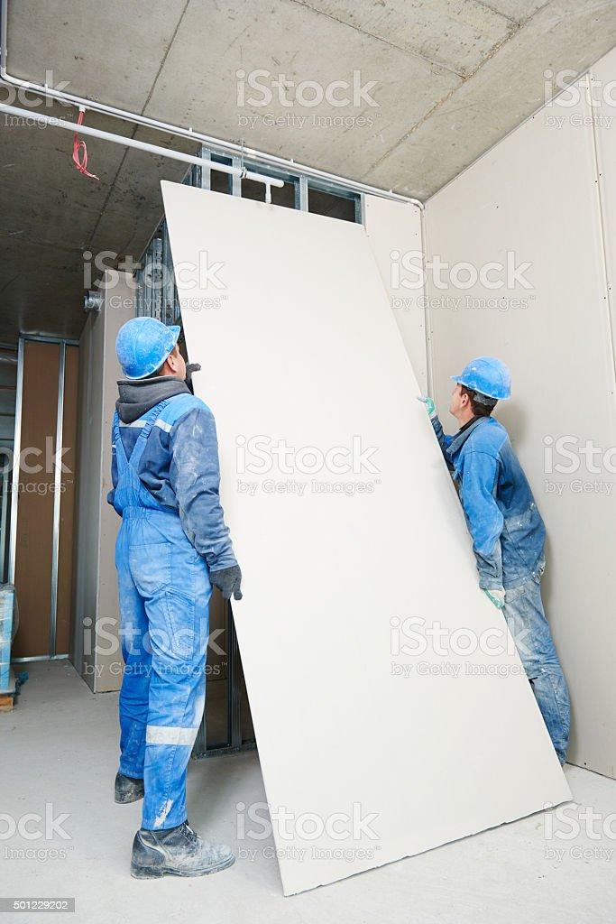 gypsum plaster board walling installation stock photo