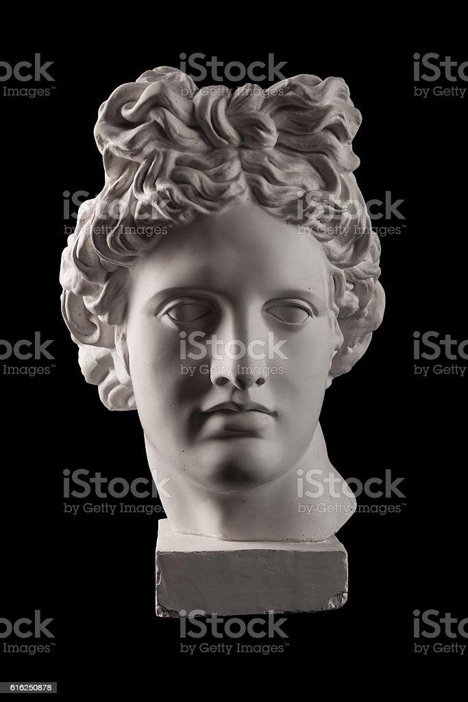 Gypsum statue of Apollo's head on a black background stock photo