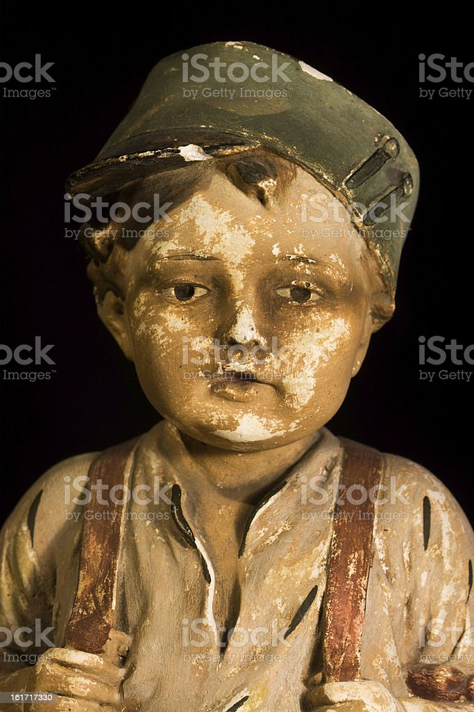 Gypsum statue of boy with cap royalty-free stock photo