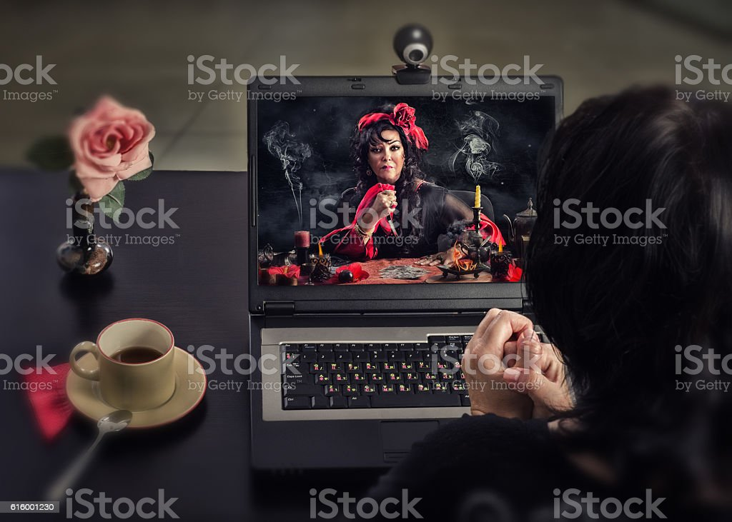 Gypsy doing deadly curse ritual for online client stock photo